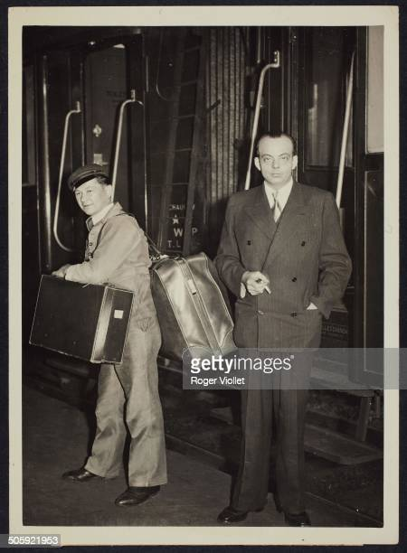 French writer and aviator Antoine de Saint Exupéry arriving at the gare SaintLazare railway station after his plane accident Paris circa 1938