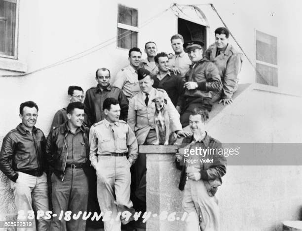 French writer and aviator Antoine de Saint Exupéry with a group of US Air Force personnel 18th June 1944 Saint Exupéry disappeared over the...
