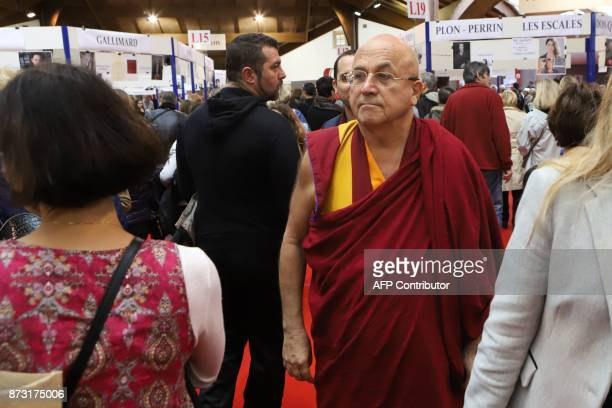 French writer and Buddhist monk Matthieu Ricard visits the 36th edition of the 'Foire du Livre de Brive' book fair on November 12 2017 in...