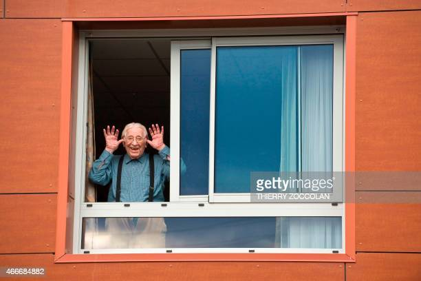 French writer and centenarian Jean Anglade poses at his retirement home in ClermontFerrand on March 17 2015 on the eve of his 100th birthday AFP...