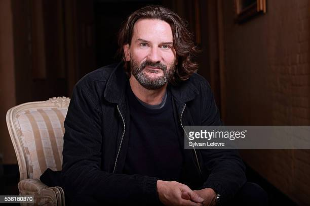 French writer and director Frederic Beigbeder poses before press conference for his last film 'L'ideal' on May 31 2016 in Lille France