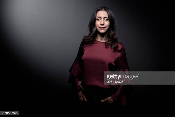 French writer and feminist activist Henda Ayari poses during a photo session in Paris on November 24 2017 Muslim feminist activist Henda Ayari told...