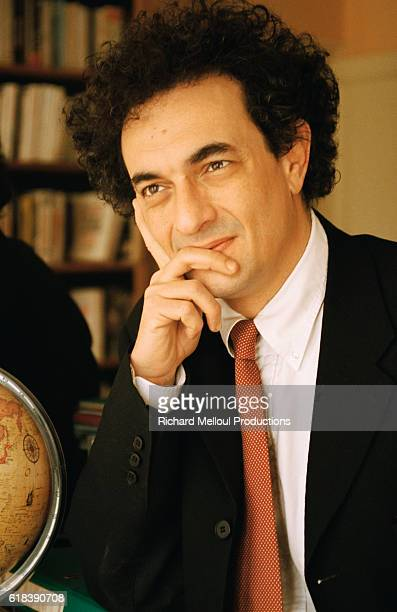 French writer and journalist GeorgesMarc Benamou leans his head against his hand