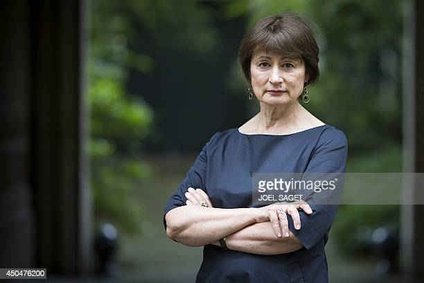 French writer and jury member for the French literary prize Prix Sade Catherine Millet poses in Paris on June 11 2014 AFP PHOTO / JOEL SAGET