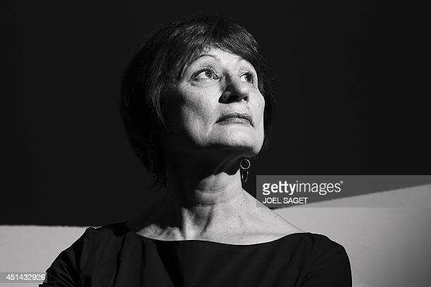 French writer and jury member for the French literary prize Prix Sade Catherine Millet poses at her home in Paris on June 11 2014 AFP PHOTO / JOEL...