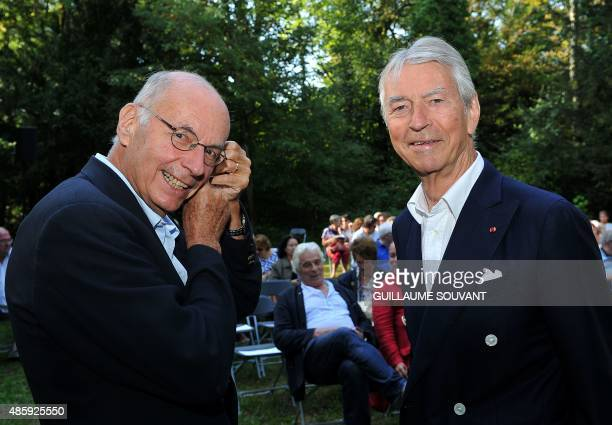 French writer and pedopsychiatrics Boris Cyrulnik and french journalist Jean Claude Narcy smile during the 20th edition of the Foret des Livres book...