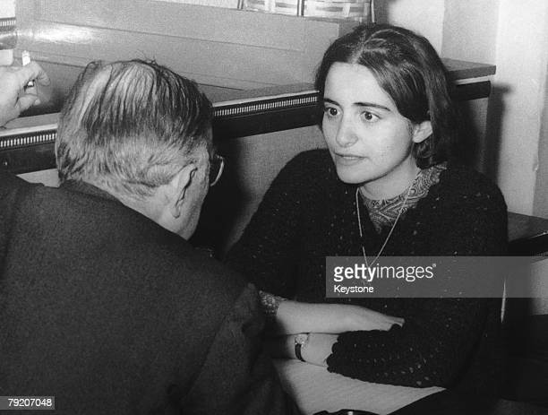 French writer and philosopher JeanPaul Sartre at a cafe in Montparnasse with his 28yearold secretary Arlette Elkaim whom he is in the process of...