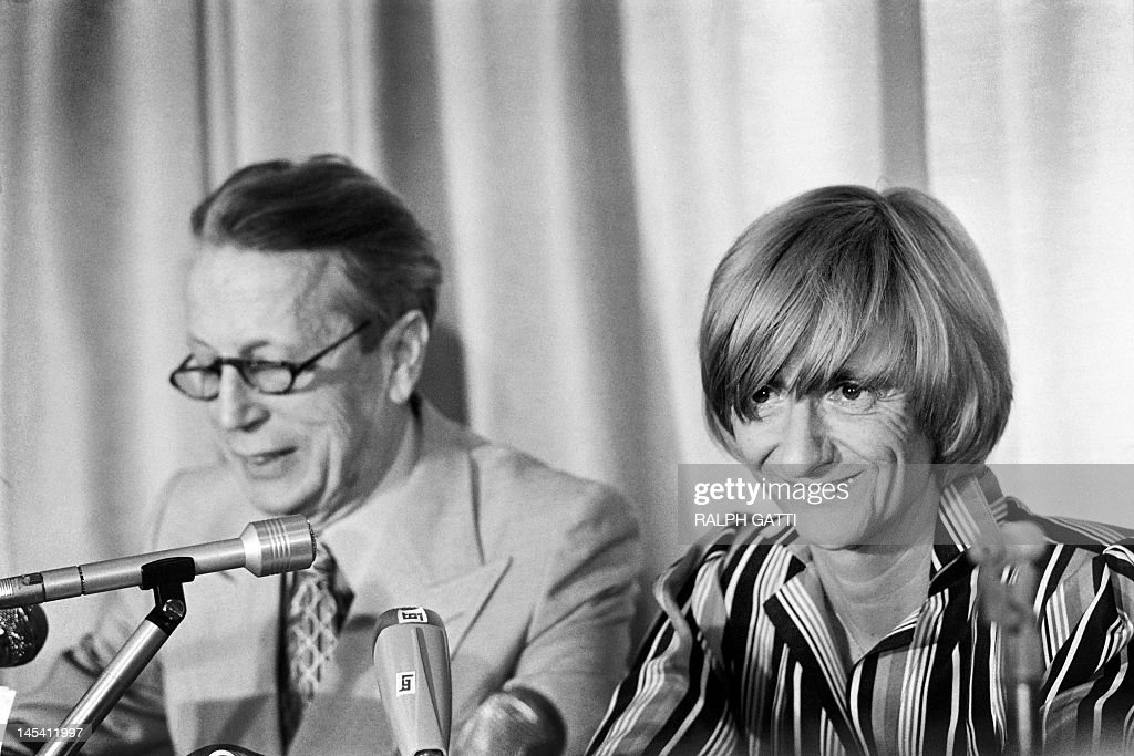 French writer and president of the Jury Francoise Sagan, flanked by President of the Cannes Film Festival Robert Favre Le Bret (L), gives a press conference during the 32th Cannes International Fil...