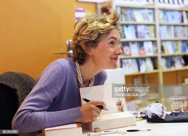 French writer Anna Gavalda signs her book 'La consolante' during the 28th Paris' Book Fair on March 15 2008 in Paris Israeli writers are the stars of...
