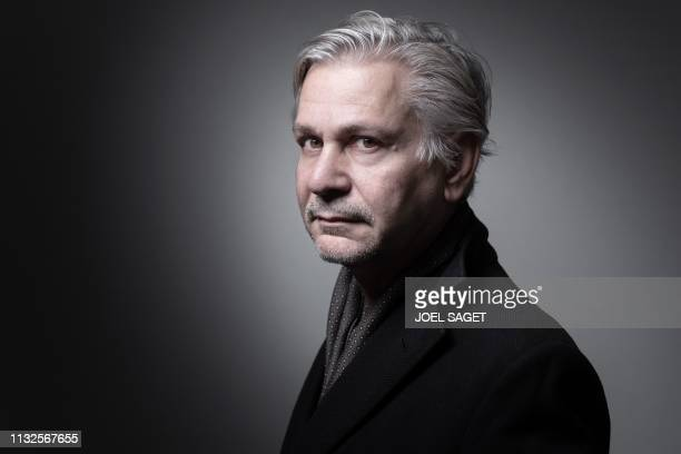 French writer Antoon Krings poses during a photo session at the Paris Book Fair 2019 at the Parc des Expositions in Paris on March 17 2019 in Paris