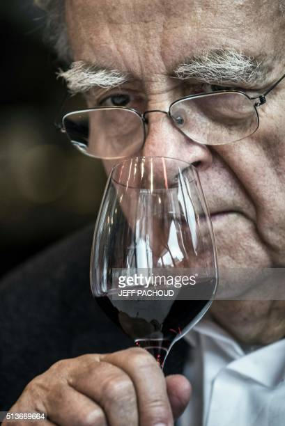 French writer Bernard Pivot smells a glass of wine on March 3 2016 in Lyon Bernard Pivot born in Lyon uses his notoriety to help improve the...