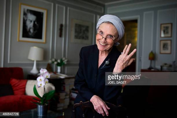 French writer Catherine RobbeGrillet poses at her home in NeuillysurSeine near Paris on June 12 2014 AFP PHOTO / JOEL SAGET