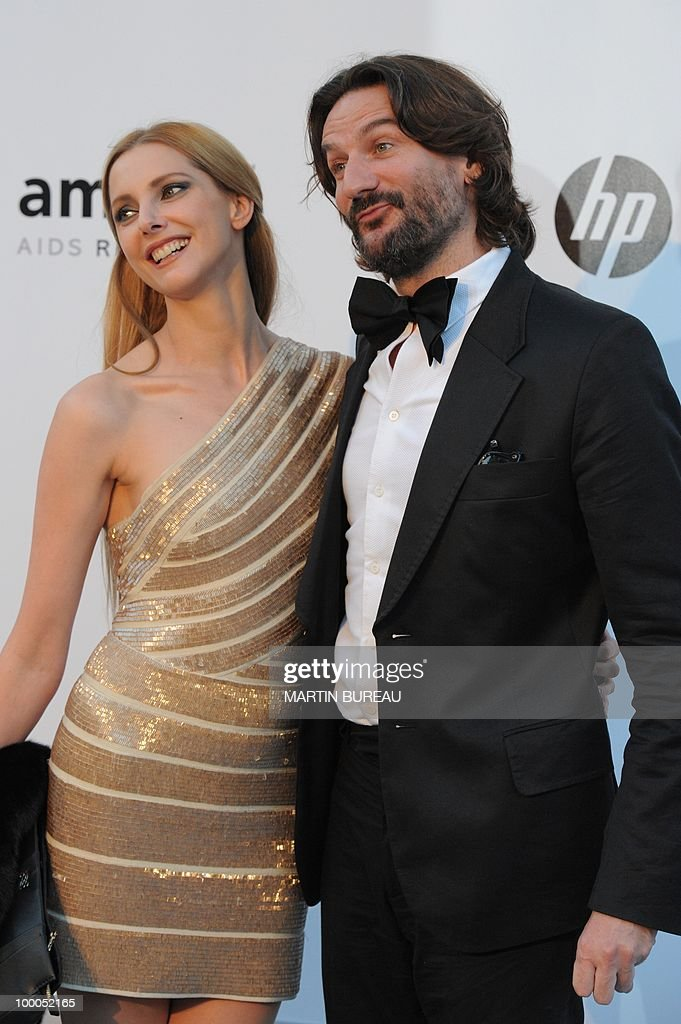 French writer Frederic Beigbeder and French actress Frederique Bel pose while arriving to attend the 2010 amfAR's Cinema Against Aids on May 20, 2010 in Antibes, southeastern France.