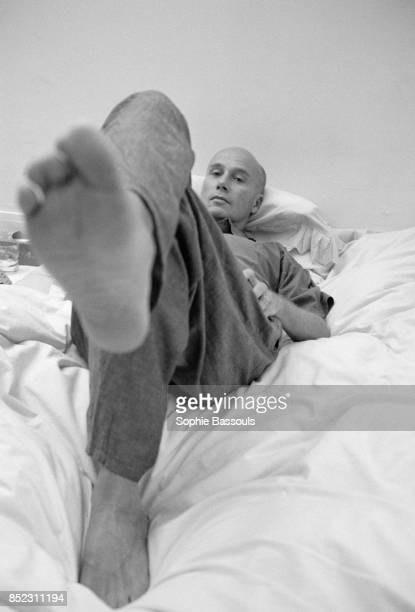 French writer Gabriel Matzneff shows the bottom of his foot as he reclines on a bed Matzneff is a novelist essayist poet and writer for various...