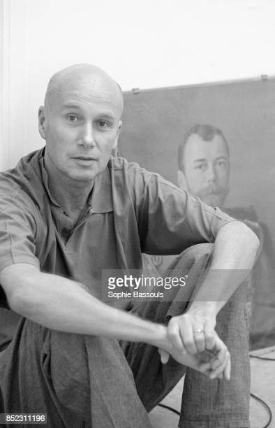 French writer Gabriel Matzneff sits on the floor next to a painting Matzneff is a novelist essayist poet and writer for various newspapers including...