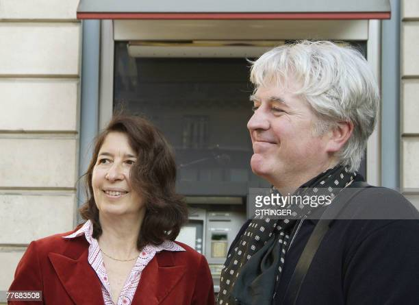 French writer Gilles Leroy and book publisher Isabelle Gallimard pose 05 November 2007 in Paris after Leroy received the 2007 French literature prize...