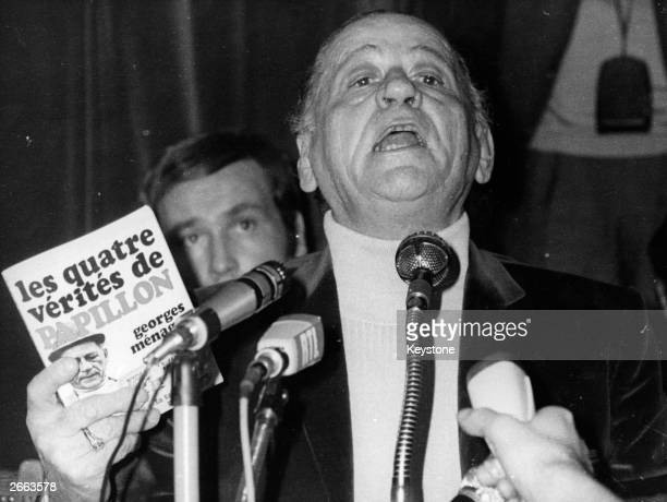 French writer Henri Charriere known as Papillon giving a press conference in defence of his recently published book Original Publication People Disc...