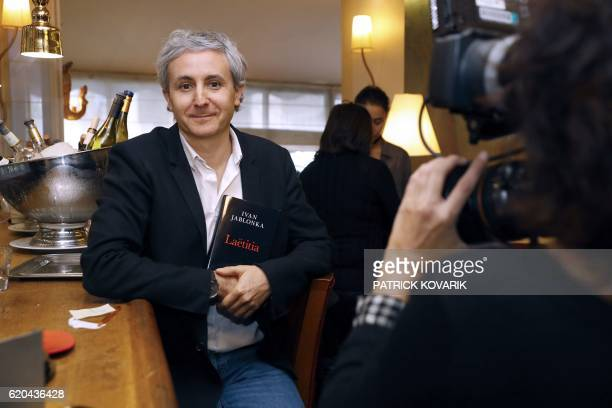 French writer Ivan Jablonka poses with his book in Paris after winning the French literary Prix Medicis prize on November 2 2016 The French literary...