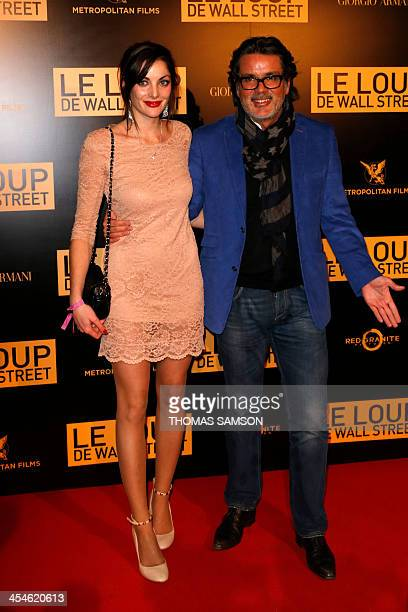 French writer JeanChristophe Grange poses with his girlfriend as they arrive to attend a party for the premiere of the film 'The Wolf of Wall Street'...