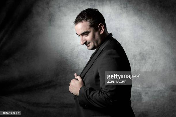 French writer Joachim Schnerf poses during a photo session on September 30 2018 in Manosque southern France during the 20th edition of 'Les...