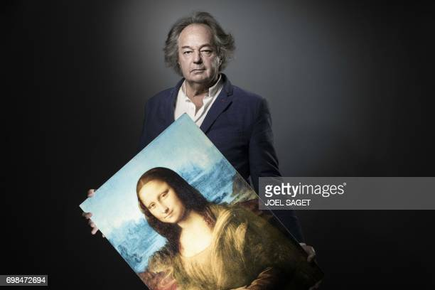 French writer journalist and artist Gonzague Saint Bris poses with his digital art piece titled 'The blue Joconde' during a photo session on June 7...