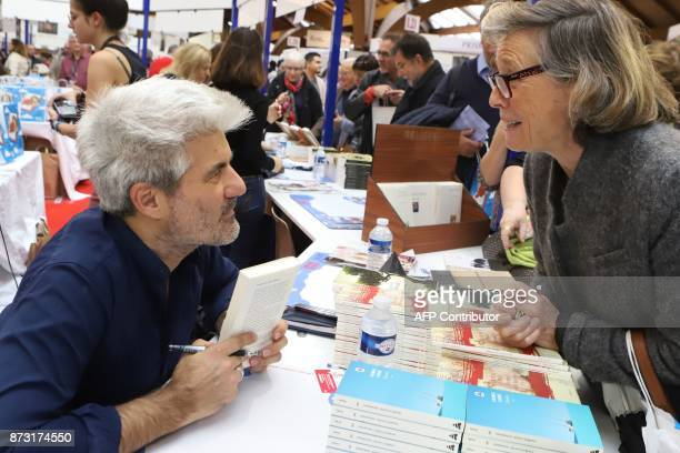 French writer Laurent Gaude President of the 36th edition of the 'Foire du Livre de Brive' book fair meets readers on November 12 2017 in...