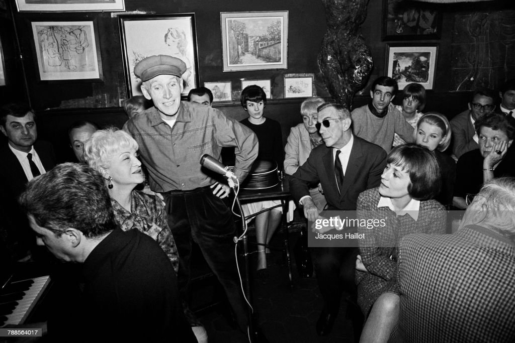 French writer Marcel Ayme and actress Annie Girardot during a show with Yvonne Darle and Paulo at French cabaret Le Lapin Agile in Montmartre.