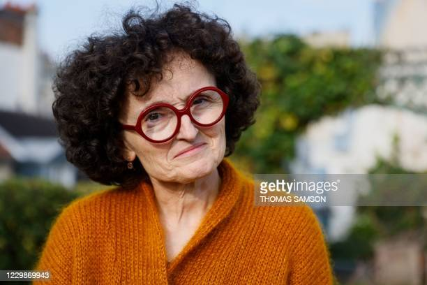 French writer Marie-Helene Lafon poses after she won the Prix Renaudot French literary award for her novel 'Histoire du fils' in Paris on November...