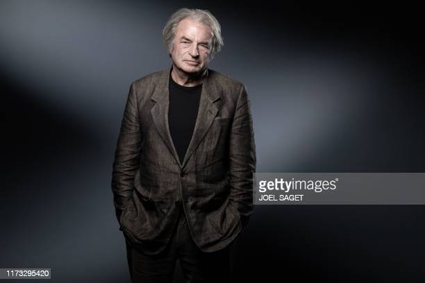 French writer Olivier Rolin poses during a photo session in Paris on October 2 2019