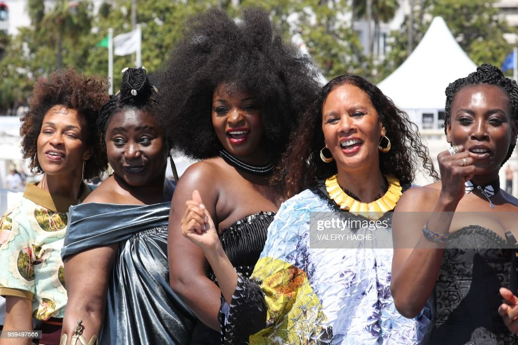 French writer Rachel Khan, French-Cameroonian Marie-Philomene Nga, French actress Maimouna Gueye, French actress and producer France Zobda and French actress and writer Mata Gabin, members of a group of 16 black women who fight for equality and inclusion of black women in the French film industry, pose on May 17, 2018 during a photocall for the book 'My Profession is Not Back' on the sidelines of the 71st edition of the Cannes Film Festival in Cannes, southern France.