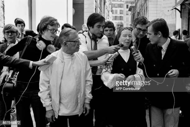 French writer Simone de Beauvoir and French philosopher JeanPaul Sartre speak to the press after leaving the Police station on June 26 in Paris / AFP...