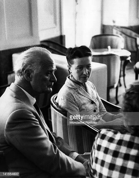French writer Simone de Beauvoir and Italian writer and painter Leonida Repaci at the dinner party in honour of philosopher JeanPaul Sartre offered...