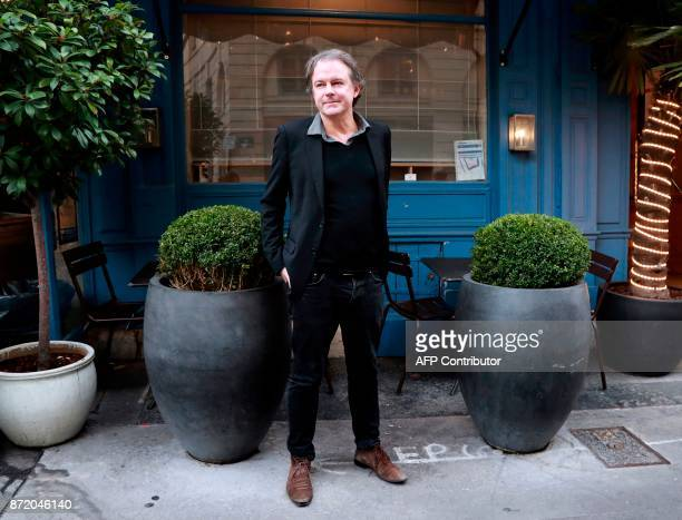 French writer Yannick Haenel poses for pictures in front of the restaurant 'La Mediterranee' in Paris on November 9 following the announcement that...