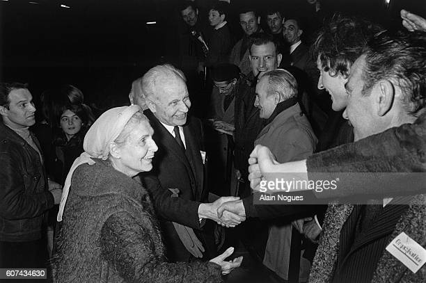 French writers Elsa Triolet and Louis Aragon greeting members of the Parti Communiste Francais or French Communist Party