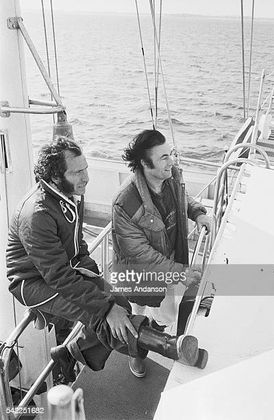 French yachtsman Alain Colas welcomes his friend the French singer Alain Barriere on board his yacht for the day