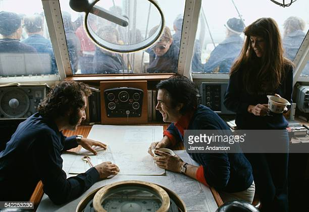 French yachtsman Alain Colas welcomes his friend the French singer Alain Barriere and his fiancee on board his yacht for the day