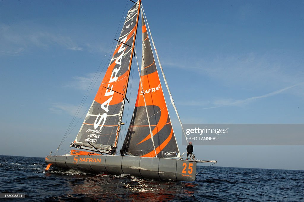French yachtsman Marc Guillemot arrives with his 'Safran' monohull in La Trinite-sur-Mer, western France, on July 7, 2013 after establishing a new record across the north Atlantic Ocean. Guillemot set a new record for a solo, single-hulled crossing of the north Atlantic Ocean, slicing more than 15 hours off the previous mark.