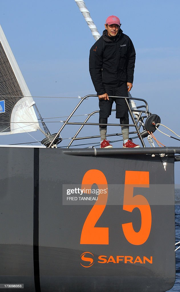 French yachtsman Marc Guillemot stands on his 'Safran' monohull as he arrives in La Trinite-sur-Mer, western France, on July 7, 2013 after establishing a new record across the north Atlantic Ocean. Guillemot set a new record for a solo, single-hulled crossing of the north Atlantic Ocean, slicing more than 15 hours off the previous mark.
