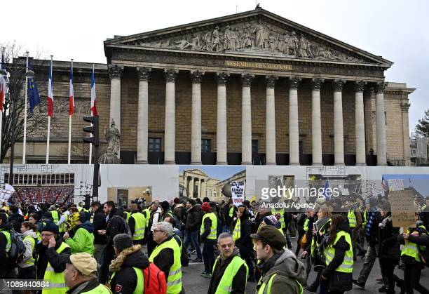 French yellow vests protesters walk near the French National Assembly during a demonstration against deteriorating economic conditions in Paris...