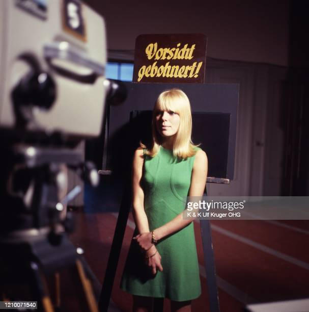 French ye-ye singer France Gall in front of a TV camera on the set of German TV Show 'Vergissmeinnicht', Hamburg, Germany, circa 1965.