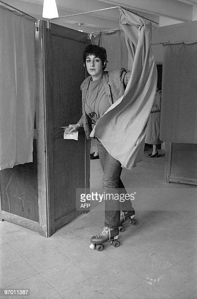 A French young voter with a walkman and rollerskates rolls out from a booth at a Paris polling station on May 10 1981 for the second round of the...