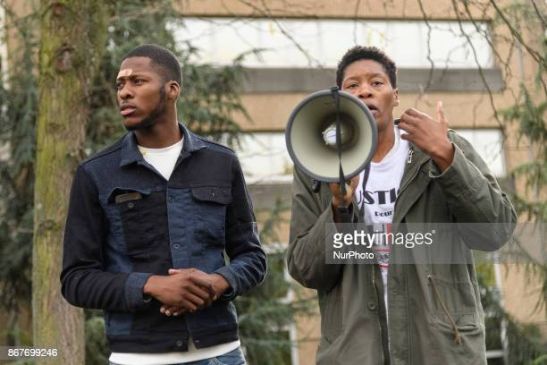 French youth worker Theo and his sister Aurelie address people during a rally against police violence organized by the Justice for Theo group outside...