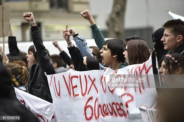 French youths and activists of various youth organisations march past the 'Hotel Des Invalides' during a demonstration against proposed changes to...