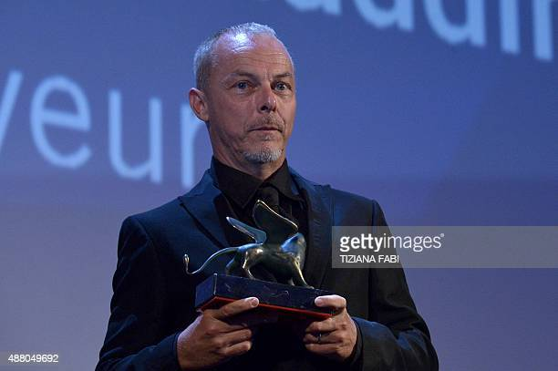 French Yves Montmayeur holds the Venice Classic award for Best Documentary on Cinema for his movie 'The 1000 Eyes of Dr Maddin' during the awards...