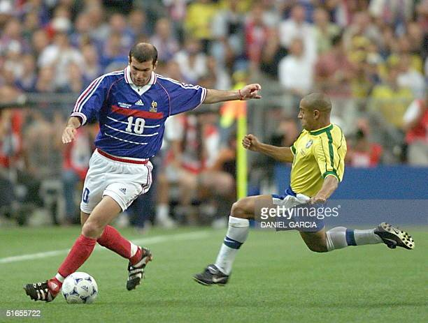 French Zinedine Zidane is challenged by Brazilian player 12 July during the World Cup final match between Brazil and France at the Stade de France in...