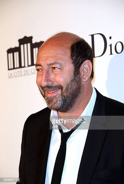 FrenchAlgerian actor Kad Merad poses as he arrives to attend the inauguration ceremony of the Cite du cinema a film studios complex heralded as...