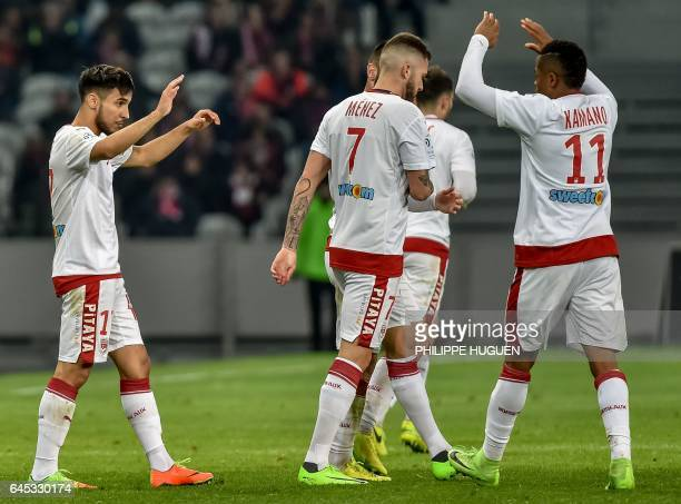 FrenchAlgerian midfielder Adam Ounas celebrates with Guinean forward Francois Kamano after he scored a goal during the French L1 football match Lille...
