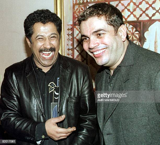 FrenchAlgerian top singer Shab Khaled shares a joke with Egyptian singer Amr Diab in Cairo 16 March 1999 Shab Khaled arrived in Egypt to record a new...
