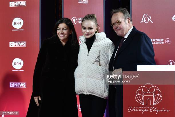 FrenchAmerican actress and model LilyRose Depp pose with Paris mayor Anne Hidalgo and President of the ChampsElysees Committee JeanNoel Reinhardt...