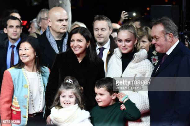FrenchAmerican actress and model LilyRose Depp poses with Paris' Mayor Anne Hidalgo president of the ChampsElysees Committee JeanNoel Reinhardt...